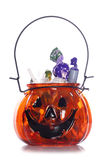 Pumpkin halloween jar full of sweets Royalty Free Stock Images
