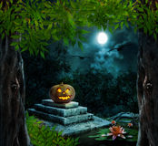 Pumpkin Halloween on old stone grave Stock Photography