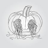 Pumpkin for Halloween with seeds dropped out through the eyes Stock Photography