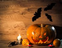 Pumpkin for Halloween on a wooden table royalty free stock image