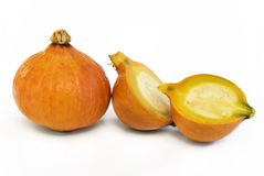 Pumpkin with halves. Pumpkin fruit with two halves on white background stock photo