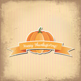 Pumpkin with Happy Thanksgiving banner and retro background Royalty Free Stock Photo