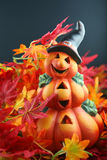 Pumpkin with hat. Halloween pumpkin lantern arranged in red and orange colored autumn leaves stock photography