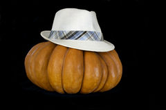 Pumpkin with hat  isolated on black Stock Photos