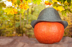 Pumpkin in a hat on a sack Royalty Free Stock Photo