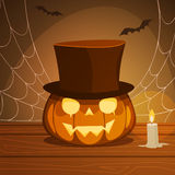 Pumpkin With Hat. On a wooden desk with candle, Halloween background Royalty Free Stock Photo