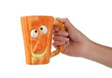 Pumpkin head coffee mug Stock Photography