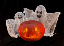 Pumpkin head with ghosts Royalty Free Stock Photos