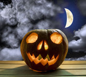 Pumpkin head for Halloween on background  sky with moon Stock Photo