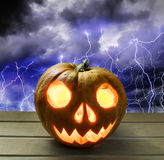 Pumpkin head for Halloween on the background of a stormy sky Royalty Free Stock Images