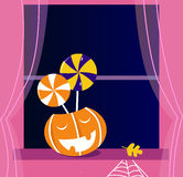Pumpkin head or Jacks o' lantern, Candy, Window Royalty Free Stock Image