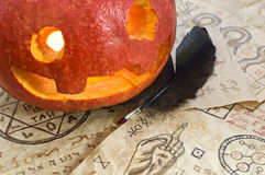 Pumpkin head with magic papers Stock Image
