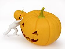 Pumpkin Head Man Pushing a Halloween Pumpkin Royalty Free Stock Photography