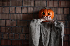 Pumpkin head monster sign hand halloween Stock Photography