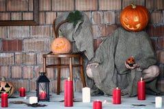 Pumpkin head monster sign hand space halloween Royalty Free Stock Image