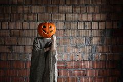 Pumpkin head monster sign hand space halloween Royalty Free Stock Photos
