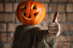 Pumpkin head monster sign hand space halloween Royalty Free Stock Photo