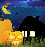 Pumpkin heads and  lonely cottage Stock Photo