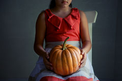 Pumpkin in his hands Royalty Free Stock Photography