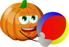 Pumpkin holding a beach ball Royalty Free Stock Image