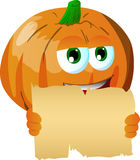 Pumpkin holding a blank old paper Royalty Free Stock Image