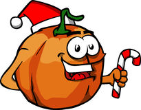 Pumpkin holding a candy cane and wearing Santa's hat Stock Image
