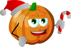 Pumpkin holding a candy cane and wearing Santa's hat Royalty Free Stock Photo