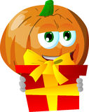 Pumpkin holding gift box Royalty Free Stock Photo