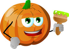 Pumpkin holding a paint brush Stock Images