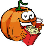 Pumpkin holding popcorn and soft drink Royalty Free Stock Photos