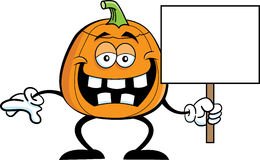 Pumpkin holding a sign Stock Image