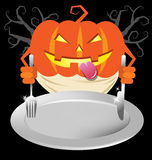 Pumpkin holding spoon and knives on dish for halloween party men Stock Photos