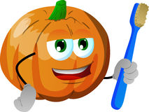 Pumpkin holding tooth brush Royalty Free Stock Images