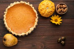 Pumpkin homemade pie at wooden background arranged with food ing Stock Image