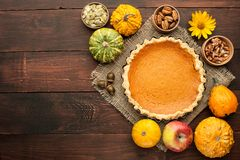 Pumpkin homemade pie at wooden background arranged with food ing Royalty Free Stock Photos