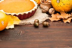 Pumpkin homemade pie at wooden background arranged with food ing Royalty Free Stock Photography