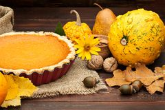 Pumpkin homemade pie at wooden background arranged with food ing Royalty Free Stock Image