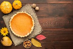 Pumpkin homemade pie at wooden background arranged with food ing Stock Images