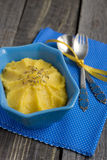 Pumpkin Hummus with cumin seeds in a blue bowl Royalty Free Stock Photos