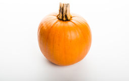 Pumpkin isolated on white background. Fresh pumpkin isolated on white background Royalty Free Stock Photography