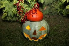 Pumpkin Jack glows at night on green grass royalty free stock image