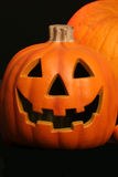 Pumpkin with jack o lantern. Grimacing smile of a scary holiday face to decorate for Halloween Royalty Free Stock Images