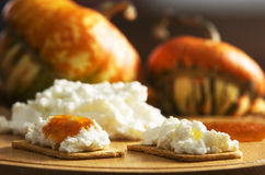Pumpkin jam. Crackers with ricotta cheese and pumpkin jam Royalty Free Stock Photo