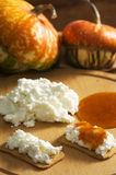 Pumpkin jam. Crackers with ricotta cheese and pumpkin jam Royalty Free Stock Photography