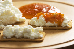 Pumpkin jam. Crackers with ricotta cheese and pumpkin jam Stock Photography