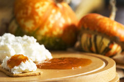 Pumpkin jam. Crackers with ricotta cheese and pumpkin jam Stock Images