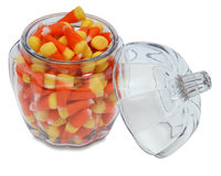 Pumpkin Jar with Candy Corn. Glass container jar shaped like a pumpkin with Halloween candy corn Stock Photography