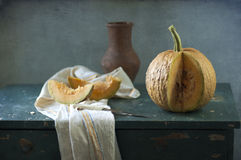 Pumpkin and jug Stock Photography