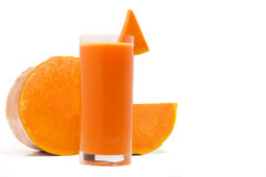 Pumpkin juice. Glass of fresh juice and pumpkin slices isolated Royalty Free Stock Images