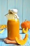 Pumpkin juice in a bottle. Royalty Free Stock Image